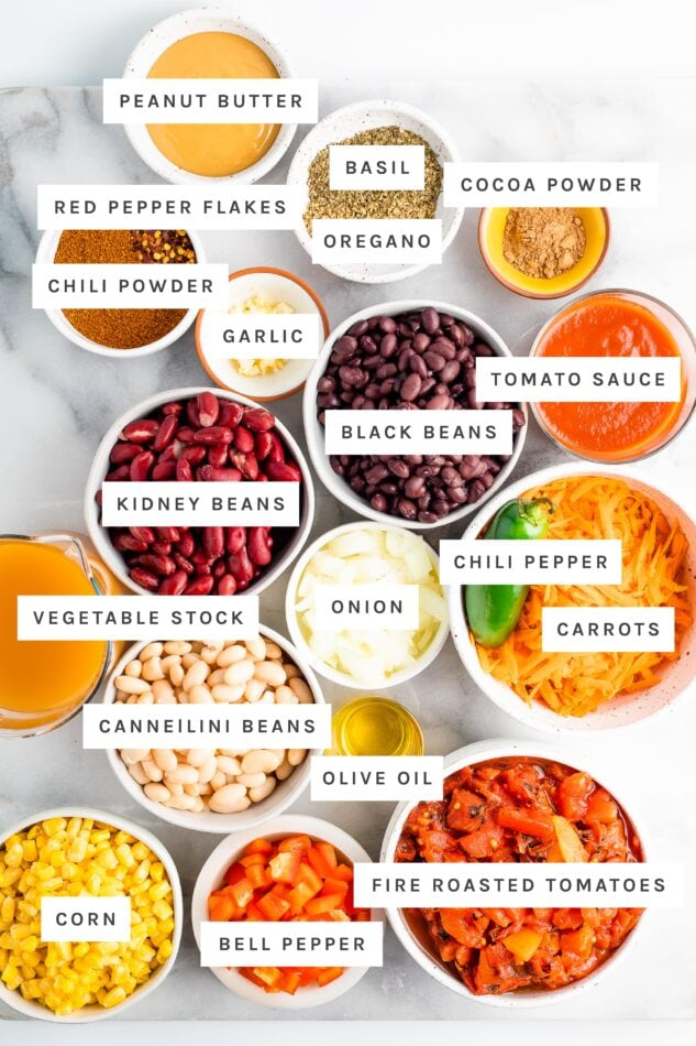 Ingredients measured out to make vegetarian chili like beans, spices, veggies, peanut butter, cocoa powder and veggie broth.