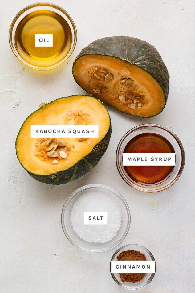 Ingredients measured out to male cinnamon maple roasted kabocha squash: oil, kabocha squash, maple syrup, salt and cinnamon.