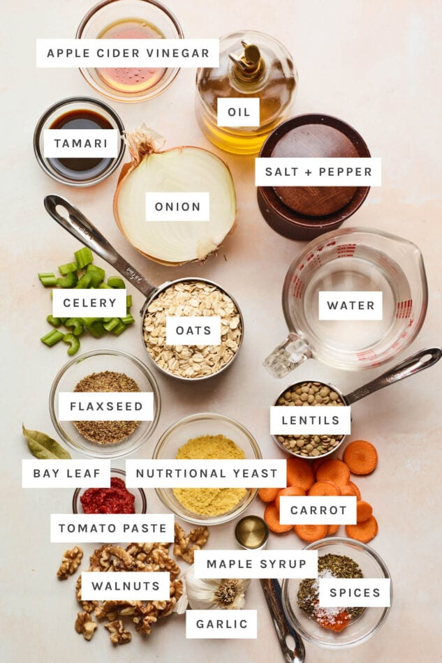 Ingredients measured out to make a lentil loaf: apple cider vinegar, oil, salt, pepper, tamari, onion, water, celery, oats, flaxseed, lentils, bay leaf, nutritional yeast, carrot, tomato paste, maple syrup, spices, walnuts and garlic.