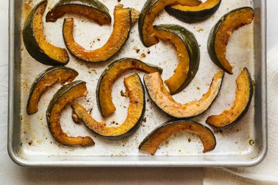 Freshly roasted Kabocha squash on a sheet pan.